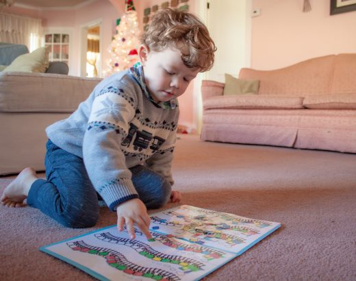 Young boy playing with file folder game