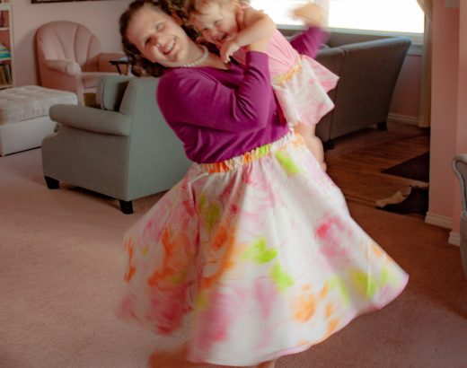 Mother and toddler girl twirling in matching circle skirts